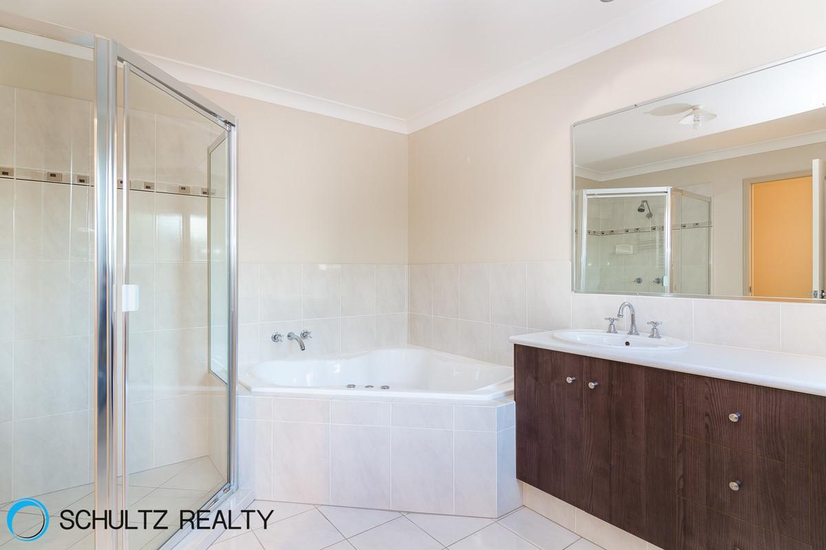 9 Riverbreeze Court,Windaroo,Australia 4207,4 Bedrooms Bedrooms,2 BathroomsBathrooms,House,Riverbreeze Court,1046