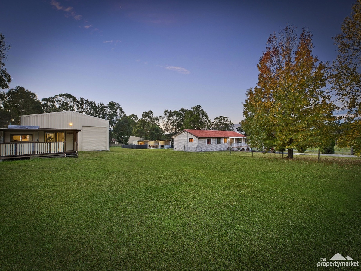Level acres, dual street frontage and town water